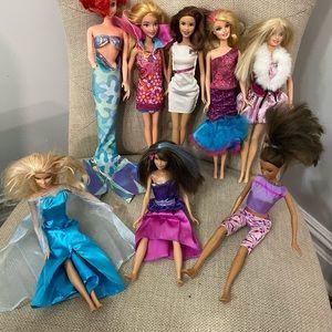 8 dressed Barbies